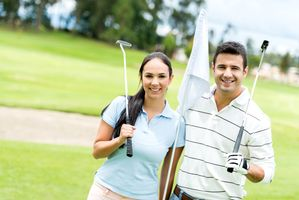 Couple at the course playing golf and looking happy