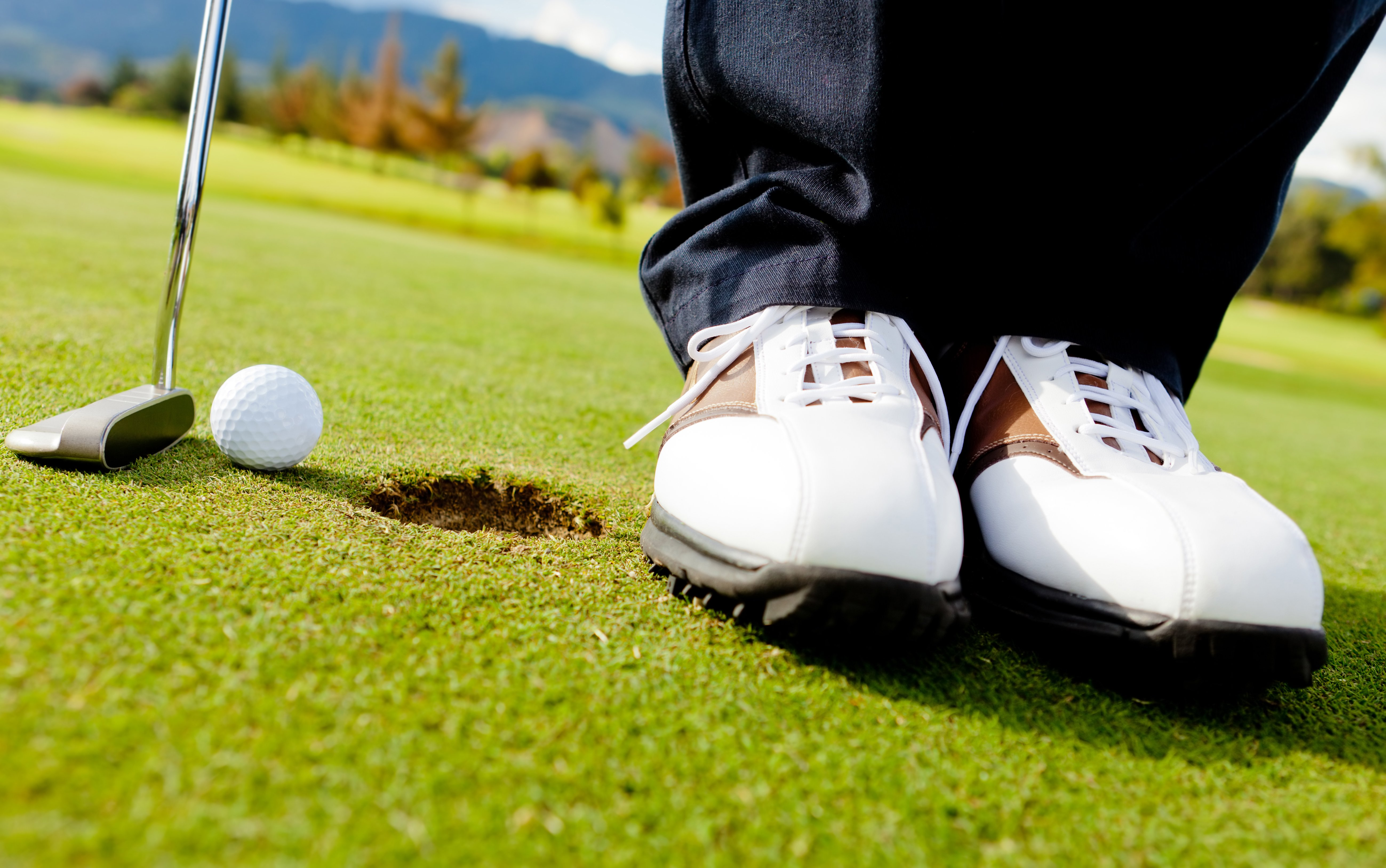 Golf player hitting the ball close-up on shoes-2